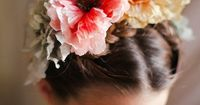 Lovely floral crown and link to pretty invitations that go with the wedding, etc.