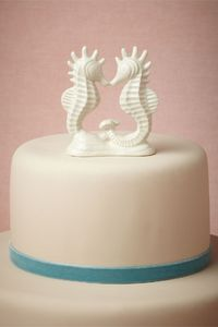Sweet seahorse cake topper from BHLDN. (Maybe for Bahamas reception...?)