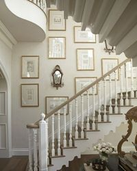 gallery walls - gold frames with black and white architectural images | Style Theories