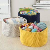 Good for extra blankets. Kneatly Knit Medium Storage Bins | The Land of Nod