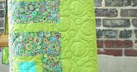 I love the Colours, the Quilting and wow it would also be a great idea for a backside of a quilt...:0)