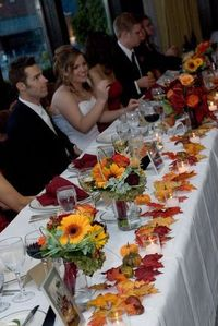 Fall wedding - head table idea-so no pumpkins but I like the leaves and flowers with purple added