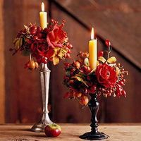 Grace your Thanksgiving table with one of these pretty centerpieces, which incorporate harvest-hue flowers and motifs.