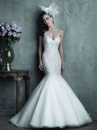 This stunning mermaid from the Allure Couture Bridal collection is fully encrusted with Swarovski crystals and pearls. This dress is sure to make a statement on your big day.