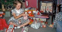 1957 Christmas photo - little girl with Little Miss Revlon and Betsy McCall dolls and a Fun With Needlepoint Kit.