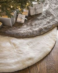 With its soft coat and exquisite color, our Lodge Faux Fur Tree Skirt is a cozy home for your presents.