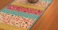 Use all my material scraps.... table runner- love the colors