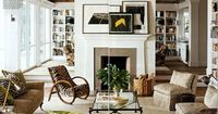 Several framed pictures placed haphazardly on mantel