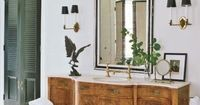 Love the stately mirror combines with a vintage furniture sink base