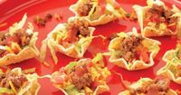 Chef Devin Alexander's Tiny Tacos 10 Tostitos Baked! Scoops 1/4 cup �nely shredded romaine lettuce 2 tablespoons �nely chopped tomatoes 1/2 ounce (about 2-1/2 tablespoons) �nely shredded Cabot's 75% light cheddar cheese, or your...