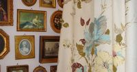 layered pics and floral curtain - doing the WHOLE WALL would be awesome