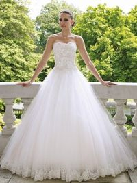 112215 - Tiana Description �€� Strapless tulle and lace ball gown with scalloped neckline, embellished hand-beaded lace bodice with three-dimensional detailing and Swarovski crystals, softly gathered full tulle skirt with matching lace appliqué hem...