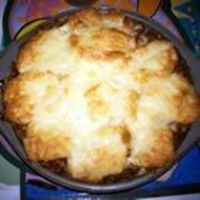 Beef and Biscuit Recipe - very yummy! Some changes I made included: used one medium onion (chopped), minced garlic, one jar of Classico Four Cheese Tomato Sauce, 2 cups cheddar cheese. To assemble, I put beef mixture on bottom on pan, then covered...