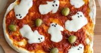 Spooky Ghost Pizza! Make ghosts out of mozzerella cheese! More Halloween ideas