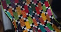 I always like quilts like this with bright colors and black and white squares
