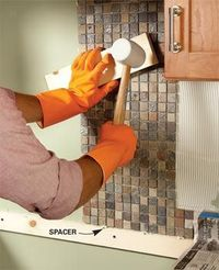 Tiling a backsplash above the counter is one of the easiest ways to upgrade an old, tired kitchen on a tight budget. You can choose from the vast array of hands