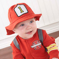 """Celebrate true heroes and heroines with one of the hottest designs in our """"Big Dreamzzz"""" collection. Baby Aspen inspires those big dreams with our Baby Firefighter layette set! Sporting """"suspenders, """"boots"""" and an absolutely adora..."""