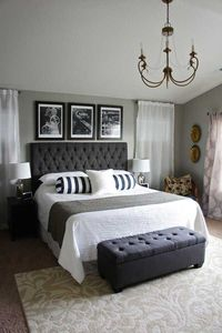 Tall bed with triptych over top